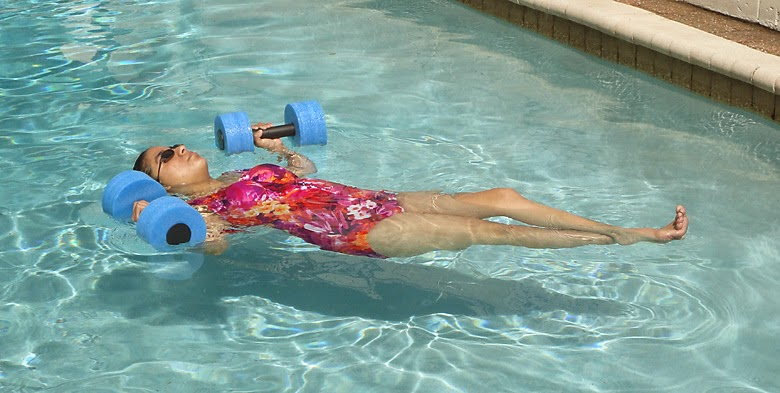 Exercising in St Francis Inn's outdoor swimming pool