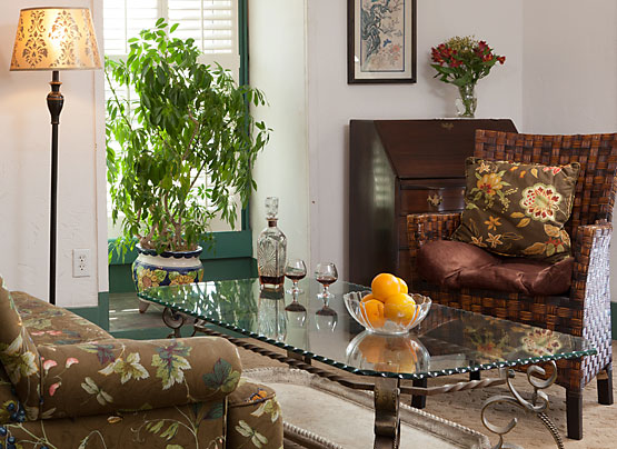 Sitting area of a guest room with complimentary sherry