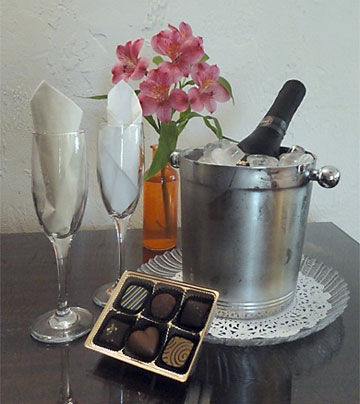 Enjoy Complimentary split of Champagne and a box of Clauds Chocolates
