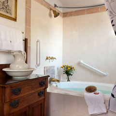 Garcia Suite tub and antique vanity