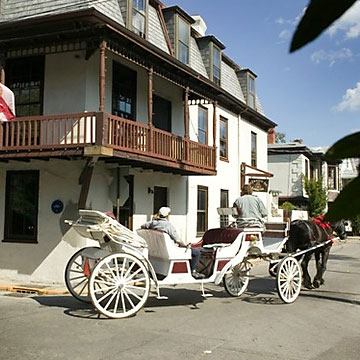 horse carriage tour passing St Francis Inn