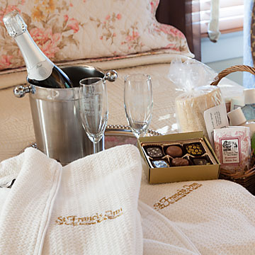 Monogrammed robes, champagne and flutes, chocolates, bath products