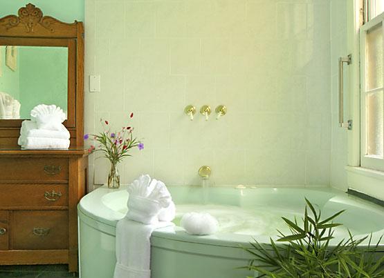 Saffron's Suite whirlpool tub and antique dresser