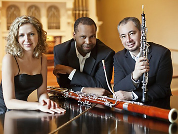 Trio performing for EMMA concert series